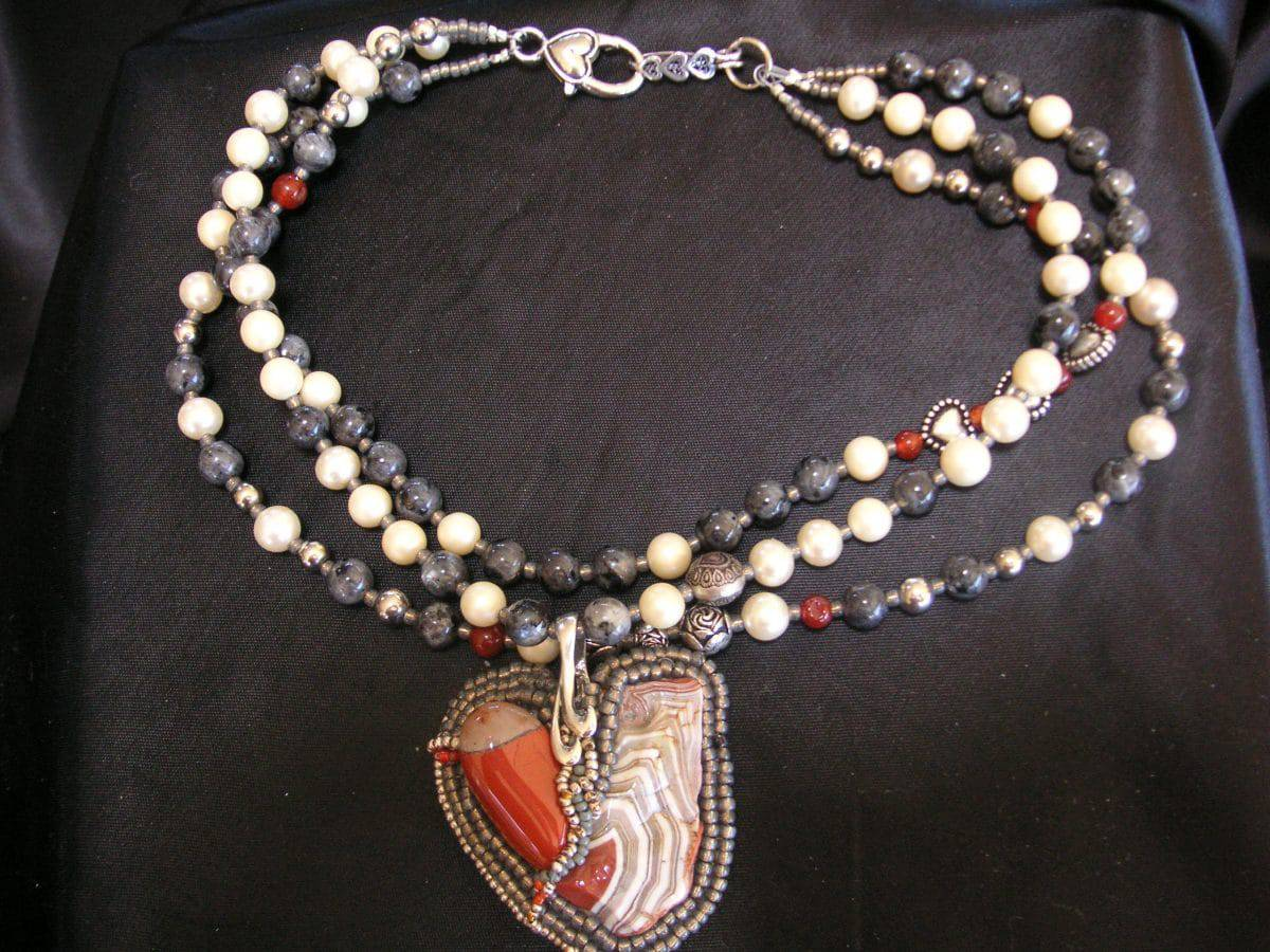 This necklace bead weaving entitled Stories From the Heart is an early work of Mary Ellen Beads.