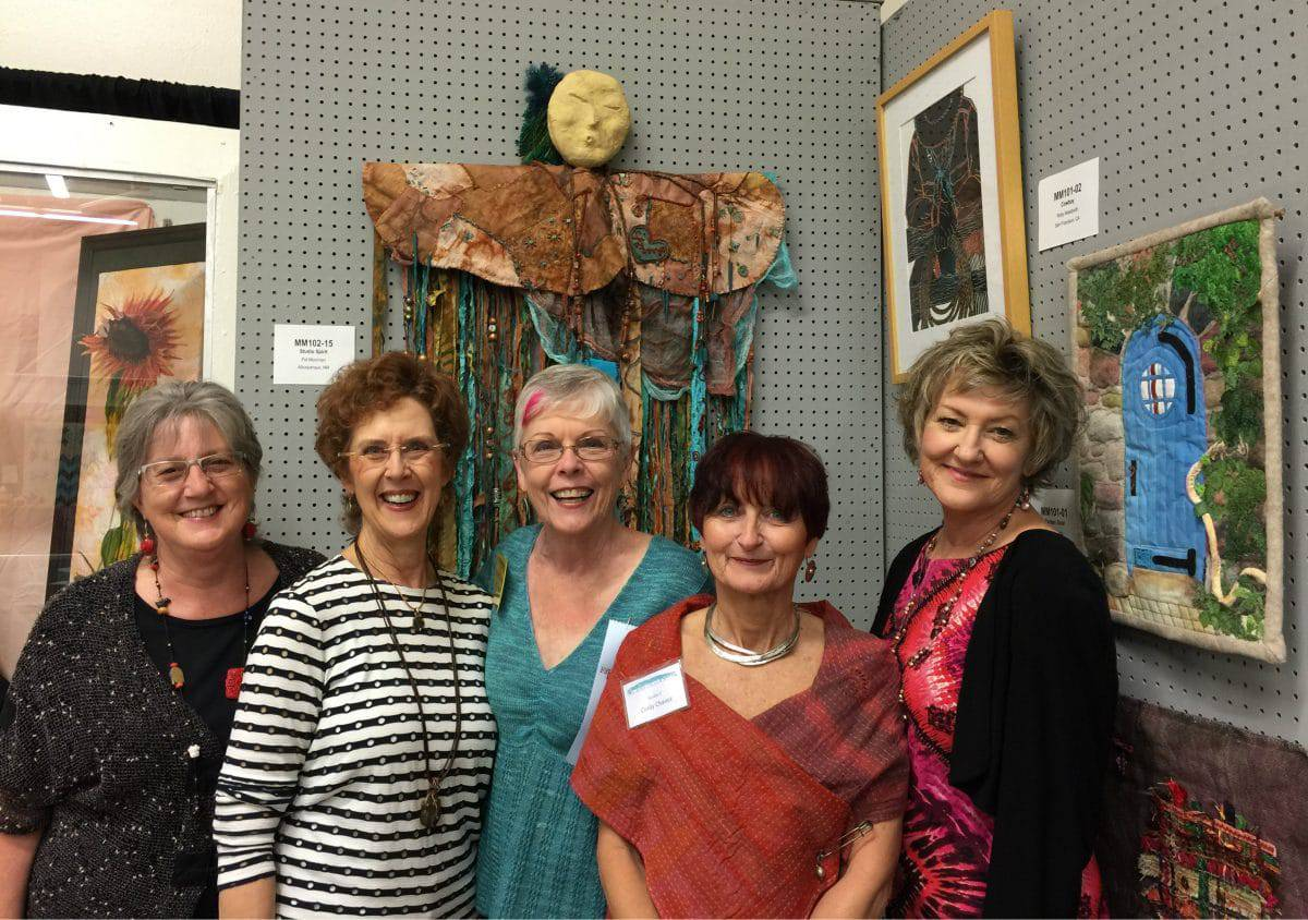 The Collaborheartists stand in front of Studio Spirit, a group creative project.