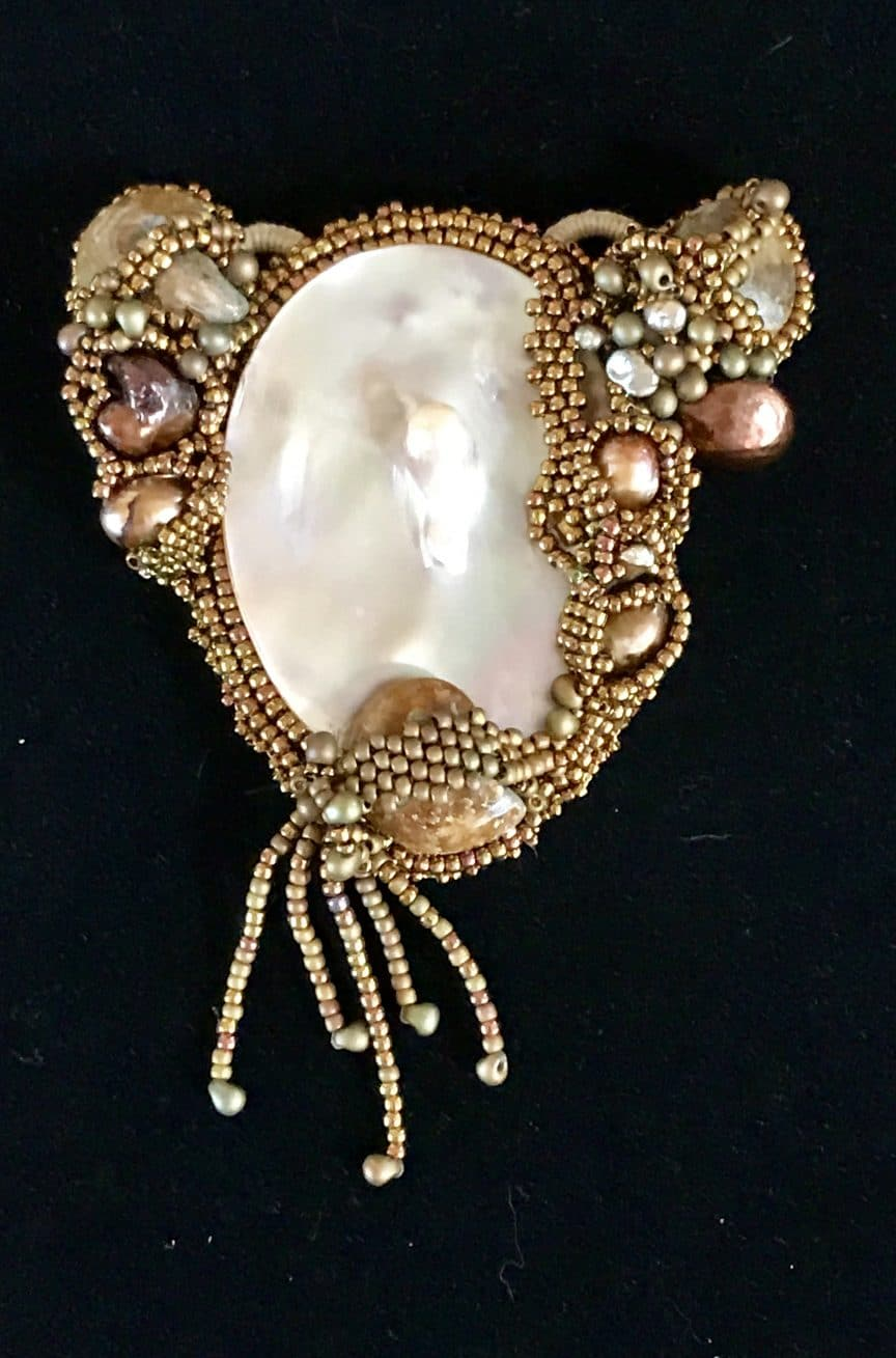 This cabochon is reflective of the unique bead embroidery offerings from Mary Ellen Beads Albuquerque.