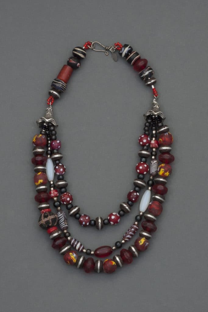 Red Sky is inspired by vintage African trade beads, part of the beyond a bead collection  trunk show by Mary Ellen Beads Albuquerque.