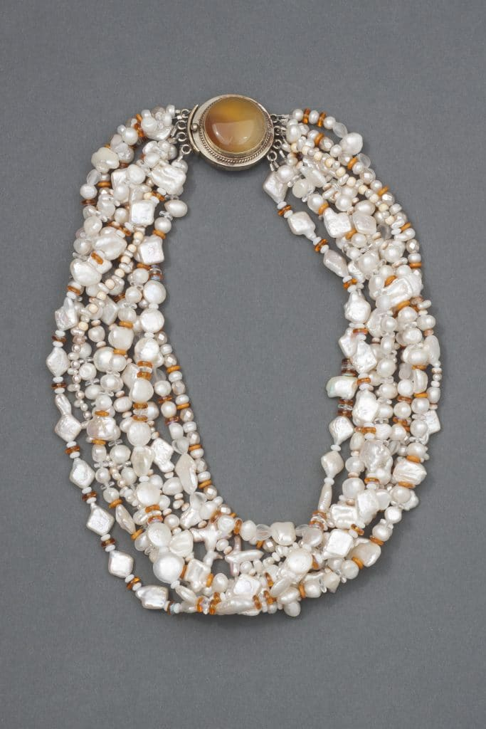 A 9-strand pearl and amber necklace is part of Beyond a Bead Collection in a trunk show by Mary Ellen Beads Albuquerque.
