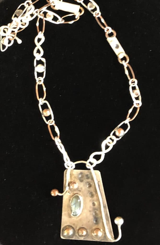 This handmade metal chain is part of a  project by Mary Ellen Beads Albuquerque.