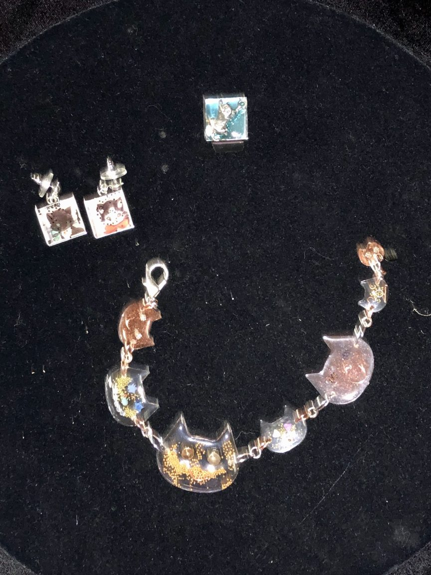 This resin project consisted of a cat-themed bracelet, earrings and ring.